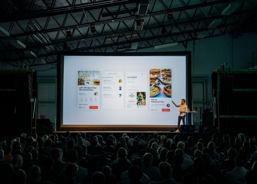 person presenting on large screen